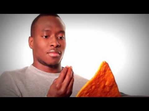Dashing Black Man Holding Dangerously Large Doritos