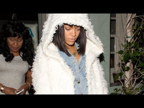 Rihanna Looking Incredibly Hot In A Large Fluffy White Jacket And Denim Hot Shorts