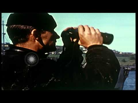 A Coast Guardsman, serving as sky lookout in a Northern France port. HD Stock Footage
