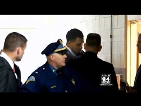 aaron hernandez smiling at viitim's mother in court