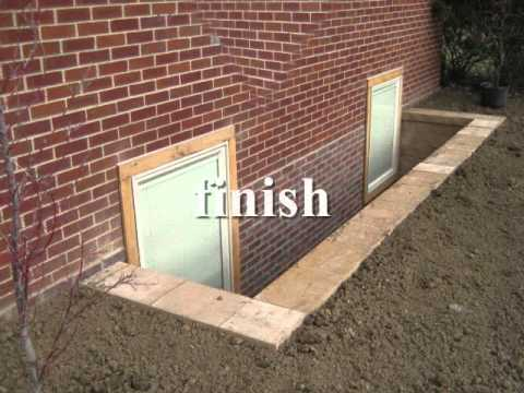 Egress basement window and walkout showroom youtube for Walkout basement windows