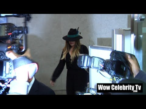 Paparazzi go wild as Khloe Kardashian is spotted arriving to LAX Airport