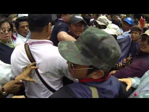 Bangkok (Thailand) 20-12-2013 Suthep Thaugsuban guards want to fight a french journalist
