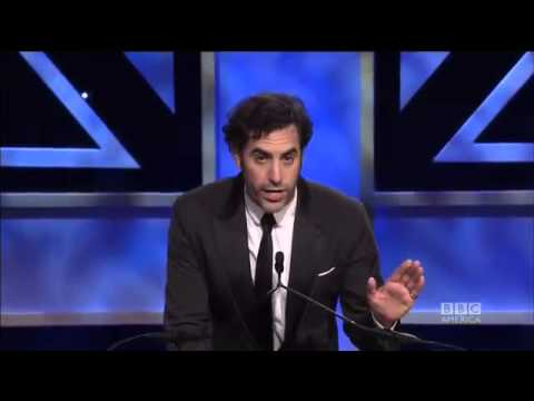 SACHA BARON COHEN Pushes Presenter Off The Stage
