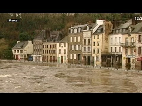 Western France and Britain raked by storms and flooding