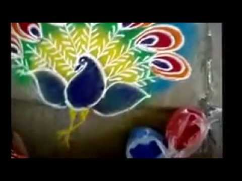 Rangoli making with peacock