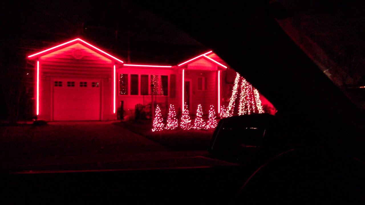 Crazy christmas lights on house move to music nutcracker for Crazy house music