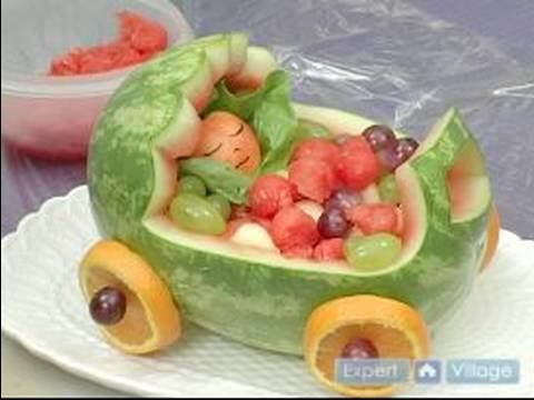 How to Carve Fruit Centerpieces : Displaying A Baby Stroller Fruit Centerpiece, How to display your baby stroller fruit centerpiece; learn more about decorating your kitchen in this free instructional video. Expert: Karen Weisman Bio: Ka...