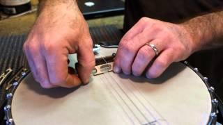 Watch the Trade Secrets Video, Do-it-yourself banjo bridge lifter