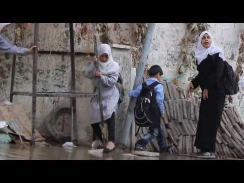 Children Navigate Sewage in the Streets of Al Sabra, Eastern Gaza City