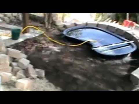 How to install a raised koi pond with water course for Do it yourself fish pond