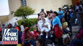 Migrant caravan arrives at US-Mexico border