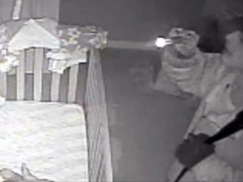 Burglar stares at sleeping infant -- caught on tape