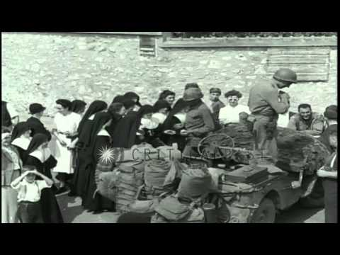 Catholic nuns speak to American soldiers in Broney, France during World War II. HD Stock Footage
