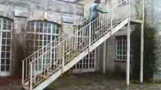 Mistress Films Slave Walking Up Metal Stairs