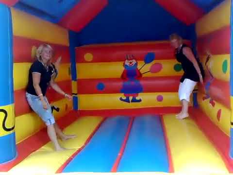 Fun of older women at the bounce castle