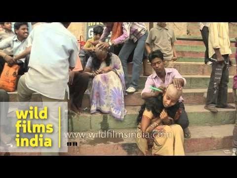Women getting their heads shaved at Varanasi ghat
