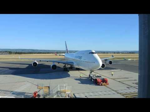 Qantas Boeing 747-400 pushback from the gate at Adelaide Airport