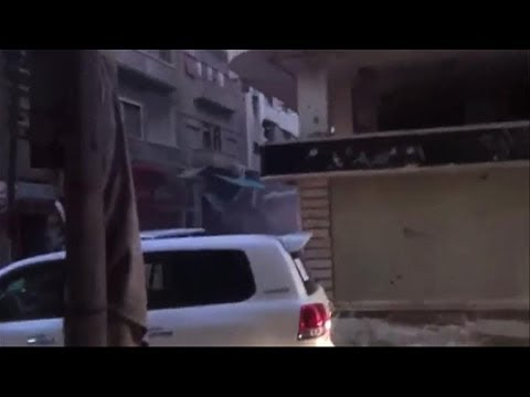 UN aid convoy fired on in Homs, Syria