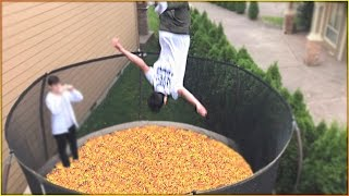 TRAMPOLINE FILLED WITH SKITTLES CHALLENGE!