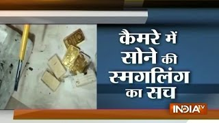 Smugglers hide gold biscuit and coin inside compressor of AC in the plane