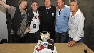 Emerson Lake & Palmer being presented with a 40Th Anniversary Cake at the High Voltage Festival view on youtube.com tube online.