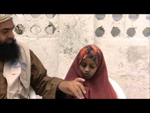 An Orphan girl recites the Qur'an
