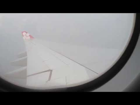VERY cloudy approach by A330-300 operated by Airasia X into brand new KLIA2