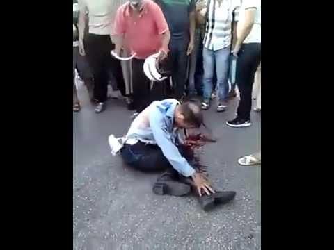 لحظة سقوط الشرطي الذي دهسته سيارة النقل السري بطنجة.