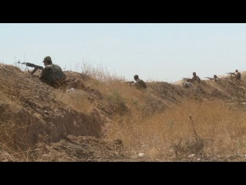 Kurdish fighters trying to keep ISIS at bay