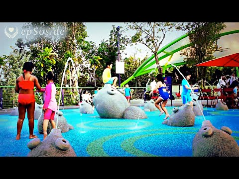Cute Asian Children Play on Wet Fountain Playground