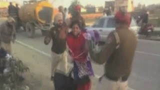 Shocking amateur footage of police beating a woman with sticks in India view on youtube.com tube online.