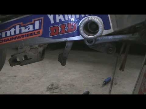 Part 21: How to disassemble a motocross bike. Removing Swing Arm. YZ250F Example.