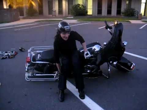 Hình ảnh trong video Hot woman pick's up a 812lb harley-davidson.
