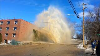 Water main break sends water, debris shooting into air