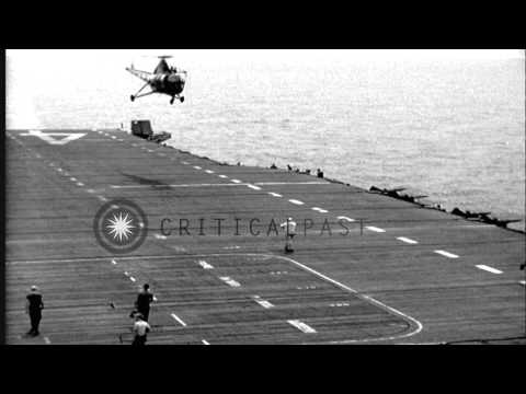 US  Sikorsky HO3S helicopter arrives and lands on the deck of USS Valley Forge (C...HD Stock Footage