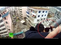 Dramatic Video: Man saves suicidal wife from falling to de..