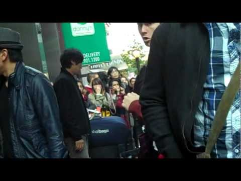 SHINee leaving W Hotel + Onew holding my gift!! (10-24-2011)