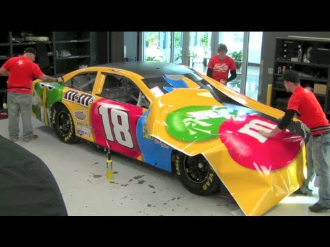 Incredible 2013 Kyle Busch M&M'S NASCAR Wrap Time Lapse - How NASCAR cars are painted, Total Elapsed time: 1 hour and 40 min. See how Kyle Busch's 2013 NASCAR Toyota Camry got its colors! The M&M'S characters Red, Green, & Brown find their home...
