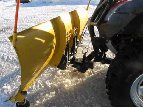 ATV Honda Rincon 680 homemade plow .wmv