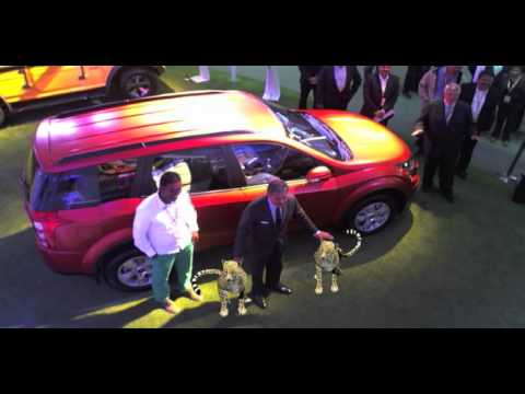 Anand Mahindra tames two cheetahs at the Auto Expo 2014!