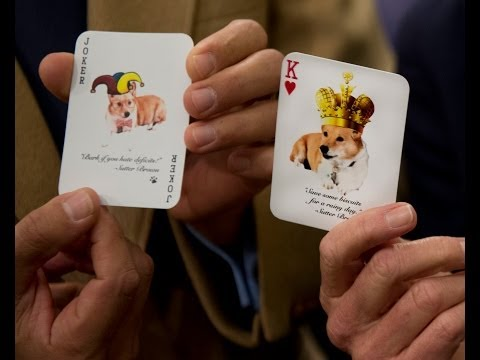 Gov. Jerry Brown shows playing card with first dog Sutter