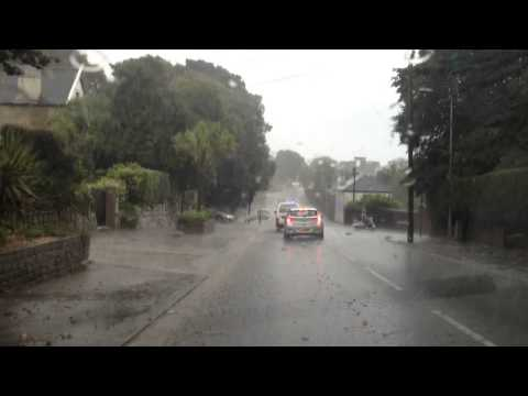 Roads close as torrential rain causes flooding in Falmouth VIDEO