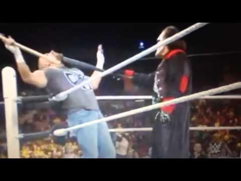 Sting attacks Triple H with a baseball bat at Fastlane!