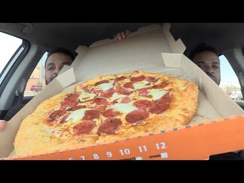 Eating Little Caesars Pepperoni Pizza