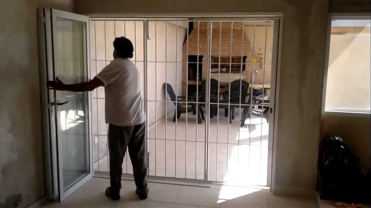 Puerta plegable reja de hierro youtube - Puertas de reja ...