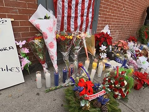 Candles, Flowers Mark Spot of Officers' Deaths