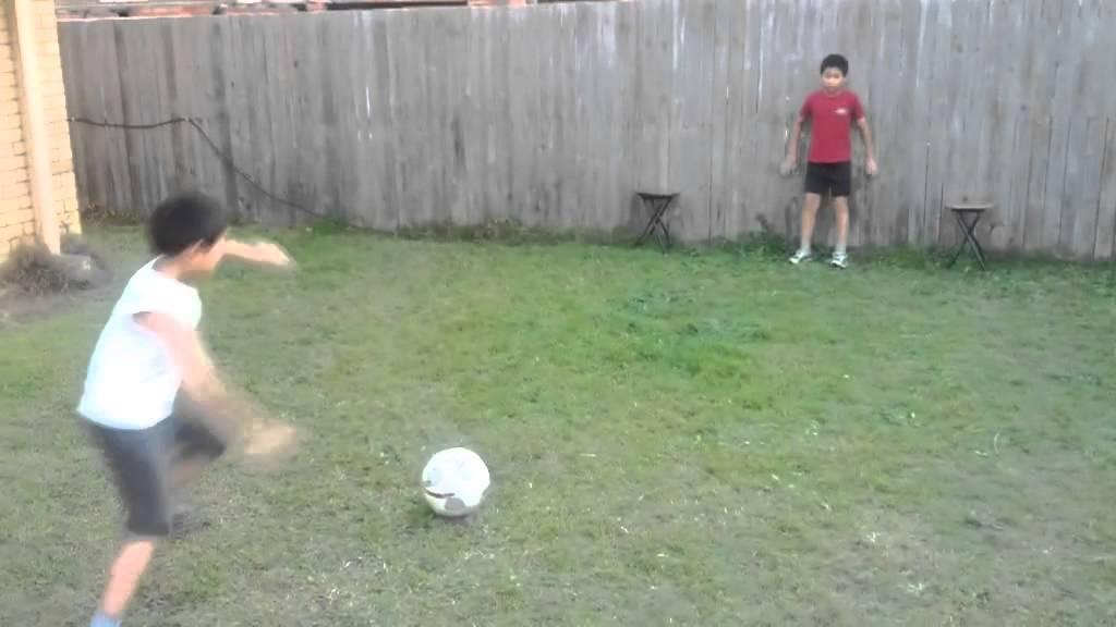backyard football play soccer goal keeping kicking future star