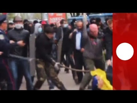 Ukraine violence: Pro-Russian militants clash with unity march in Donetsk