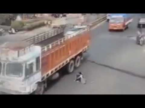 Biker Miraculous escape after being dragged under truck --INDIA NAGPUR- EXCLUSIVE FOOTAGE